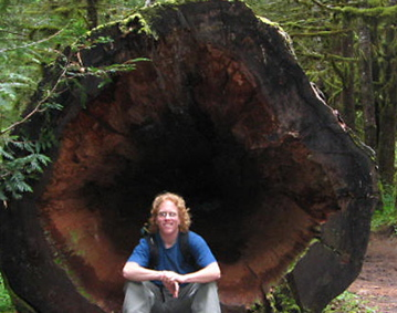 eli-sitting-in-old-growth-log